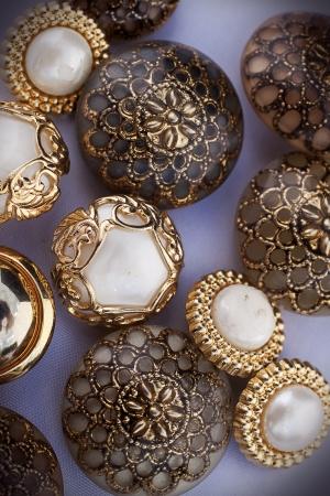 haberdashery: A group of golden vintage buttons  Haberdashery, creativity  Stock Photo