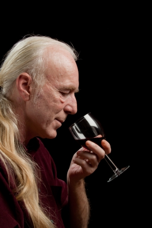 Wine expert about to taste red wine, portrait. photo