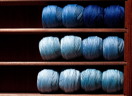 indigo: Close-up on blue thread reels in a haberdashery shop. Stock Photo