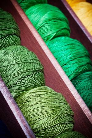 haberdashery: Close-up on green thread reels in a haberdashery shop.