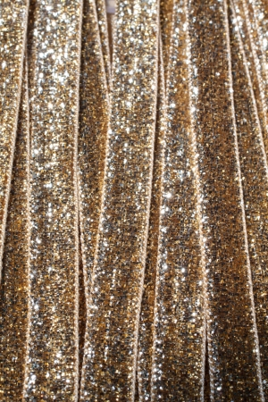 haberdashery: Gold ribbon texture for sale in a haberdashery shop..