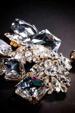fake diamond: Closeup on shiny crystal buttons Stock Photo