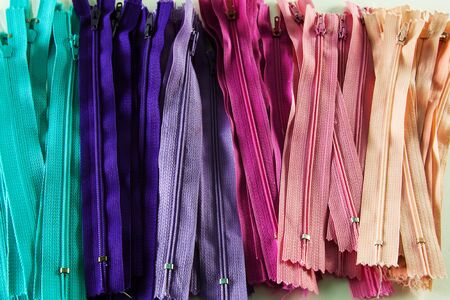 haberdashery: Colourful zips in shades of blue, purple and pink.