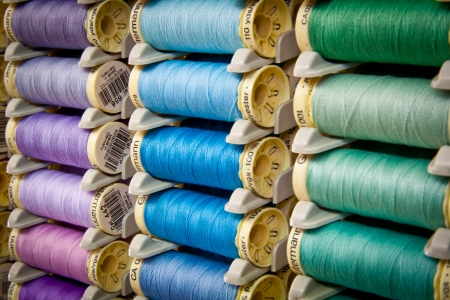 hues: Reels of thread in a haberdashery shop  Green, blue and purple hues