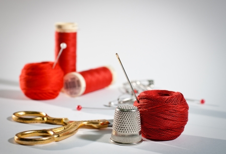 people sewing: A sewing kit in red, landscape