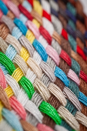 A braid of colourful sewing threads, side view  Macro photography