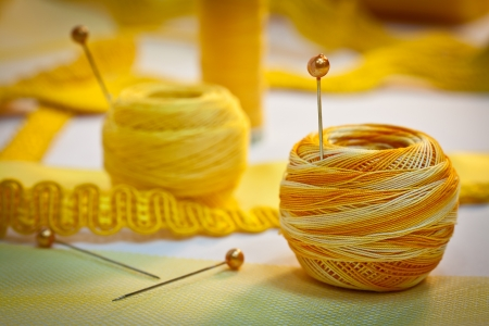 polyester: Yellow sewing and embroidery thread with pins, ribbons, haberdashery