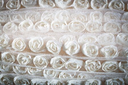 white trim: White lace trim with roses Stock Photo