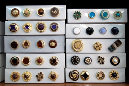 haberdashery: Boxes of vintage buttons for sale in a haberdashery shop