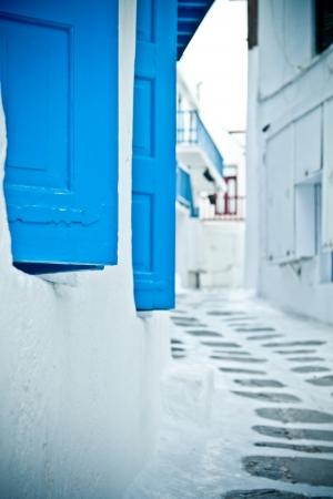 backstreet: Blue shutters close-up on a quiet back street in Mykonos, Greece.