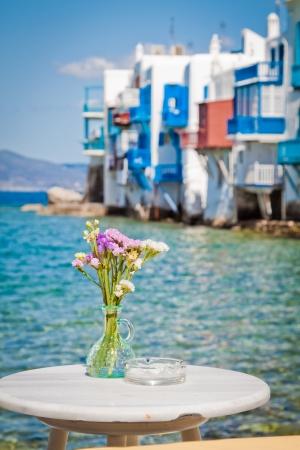 Table on the sea in Little Venice, Mykonos, Greece  photo
