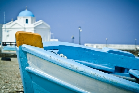 A blue boat on the beach in the old harbour, Mykonos, Greece  Stock Photo - 13897640
