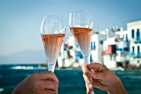 A romantic toast by the sea in Greece