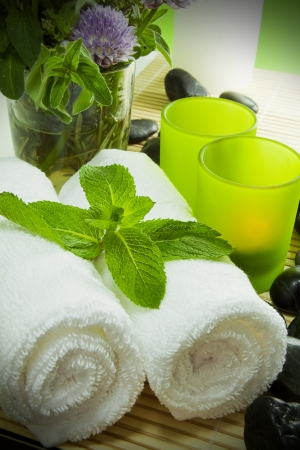 Warm towels, candles, herbs and zen stones for a spa treatment  photo