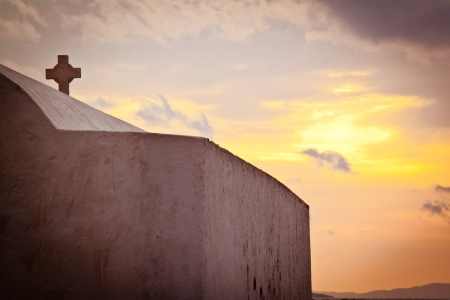 hallowed: Church on the beach in Mykonos, Greece, at sunset