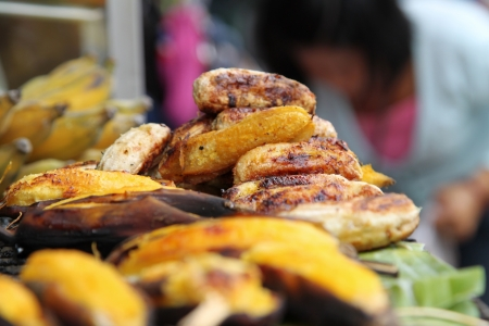 A street food stall selling delicious grilled bananas in Bangkok Stock Photo - 13899091