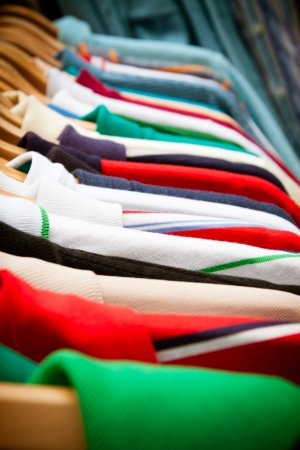 A rack of second-hand shirts and t-shirts at a market in London  recession bargains  photo