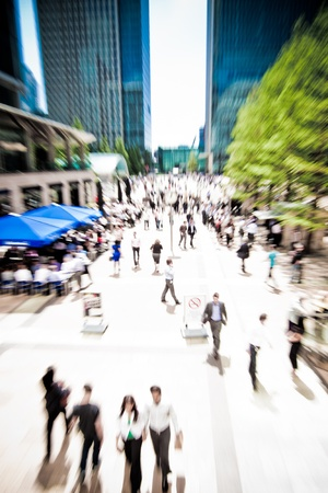 Zoom on business people rushing around at Canary Wharf, London  Motion blur  photo