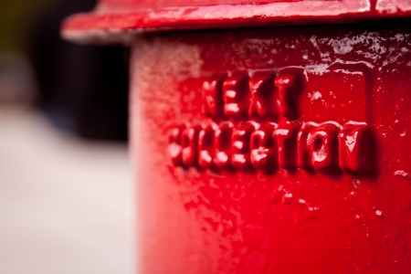 Post and mail series  close-up on red UK pillarbox  Selective focus  Portrait orientation  photo
