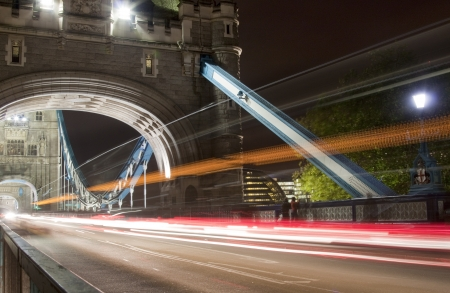 taxi famous building: Tower bridge with light trails