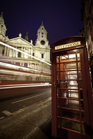 A red bus speeding past St Paul photo