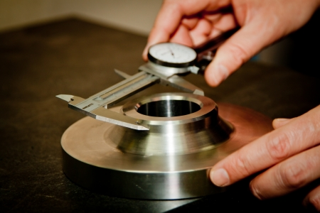 cnc: High precision measurement tool in a mechanics plant   Stock Photo