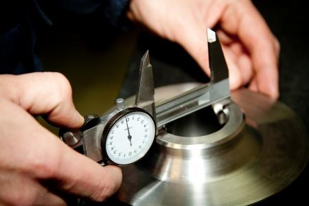 precision: High precision measurement tool in a mechanics plant   Stock Photo