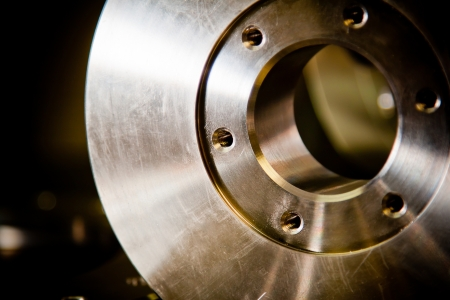 on the lathe: Custom-milled machine part made with CNC machine.