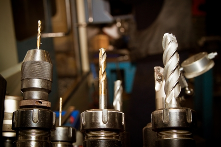 with bits: Drilling machine bits in a high precision mechanics plant