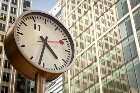 London 14 June 2011: Clock in Canary Wharf, outside Reuters, in London Editorial