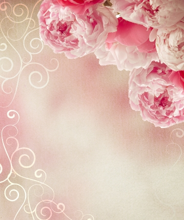 Vintage peonies on canvas background with a retro feel  Great as a greetings card or for a love message  photo