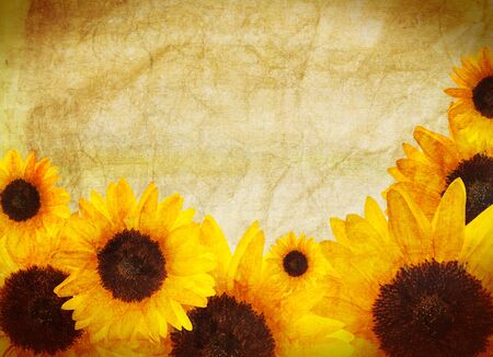 Yellow border made of beautiful bright sunflowers  Distressed vintage look  Summer concept  photo