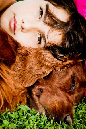 A girl on the grass with her beloved red setter  photo