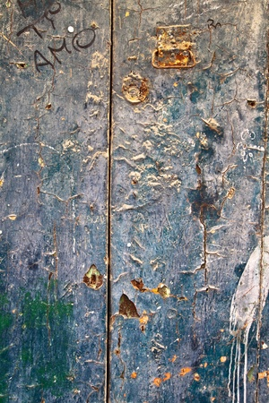 Detail of blue weathered old door with peeling paint Stock Photo - 14978272