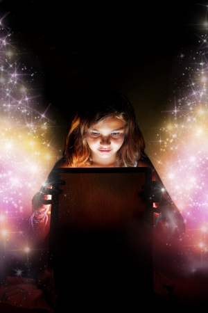 golden glow: A little girl opening a magic boxpresent setting the stars free