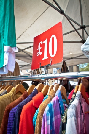 bargain for: A bargain for a tenner. Second hand clothes rack at market. Portrait orientation.