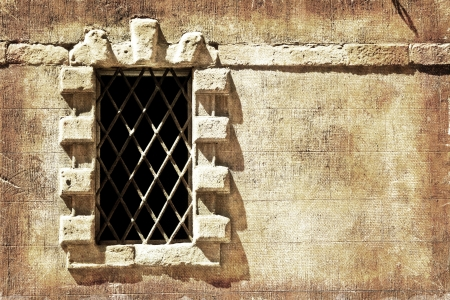 Window of a Renaissance palace in Siena, Tuscany, Italy  Desaturated color and distressed treatment for a retro feel  photo