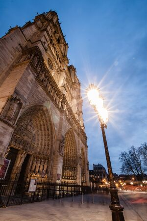 The beautiful gothic facade of the cathedral of Notre Dame at dusk. Paris, France. photo