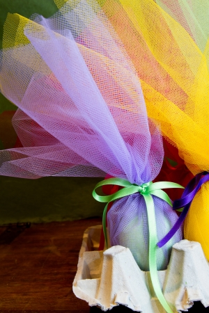 tulle: Easter eggs wrapped in tulle with a satin ribbon  Green and yellow yellow and purple, pink and red and orange  Spring, rebirth
