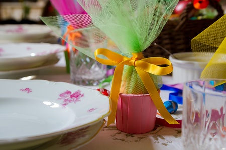 tulle: Easter table setting with eggs wrapped in mesh fabric and ribbon. Shallow depth of field, focus on the yellow ribbon.  Stock Photo