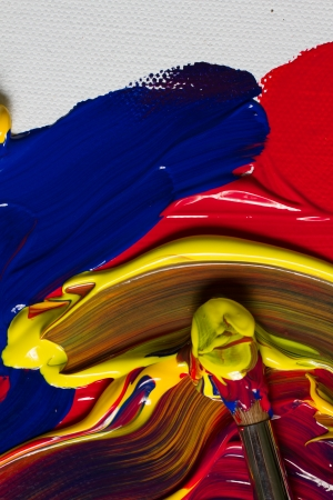 primary colours: Painted texture using primary colours (red, yellow and blue) with copy space. Focus on top part of painted area.