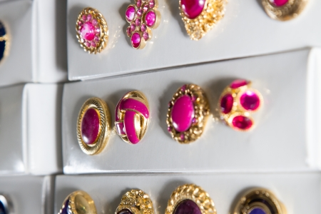 customise: Boxes of precious, jewel-like vintage buttons stacked in rows in a haberdashery. Stock Photo