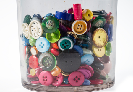 customise: Big glass jar containing lots of colorful vintage buttons.