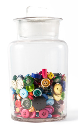 customise: Big glass jar containing lots of colorful vintage buttons. Isolated against white background, with faint shadow on bottom right.