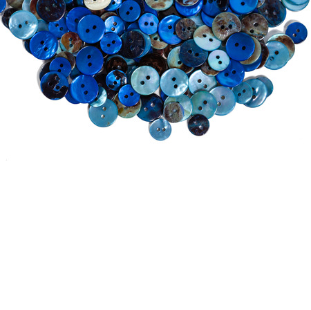 customise: Frame or border of mother-of-pearl blue buttons against a white background. Plenty of copy space. Stock Photo