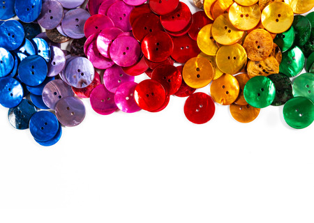 Colorful buttons on white background: blue, pink, red and yellow. Plenty of copy space. I have kept the very slight shadows to maintain realism.