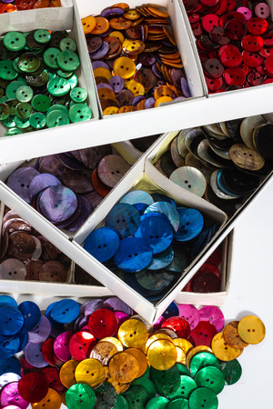 customise: Boxes full of mother-of-pearl buttons in a variety of colours.