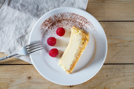 Homemade delicious cheesecake with raspberries. photo