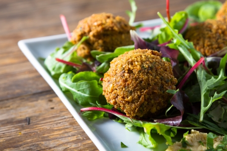 Middle East cuisine: a plate of delicious falafels and hummus. Vegetarian fare.