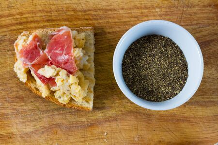 Scrambled eggs with ham on toasted bread. photo